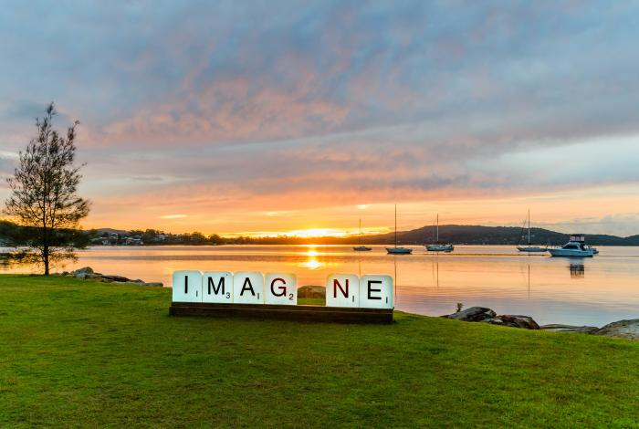 Photograph of Brisbane waters and 'Imagine' public art installation